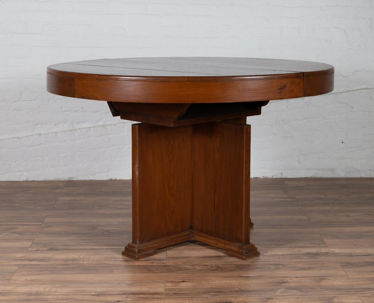 Antique Indonesian Dining Table with Central Folding Leaf and Geometric Base For Sale 3