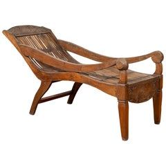 Antique Indonesian Reclining Plantation Chair with Bamboo Slats and Carved Décor
