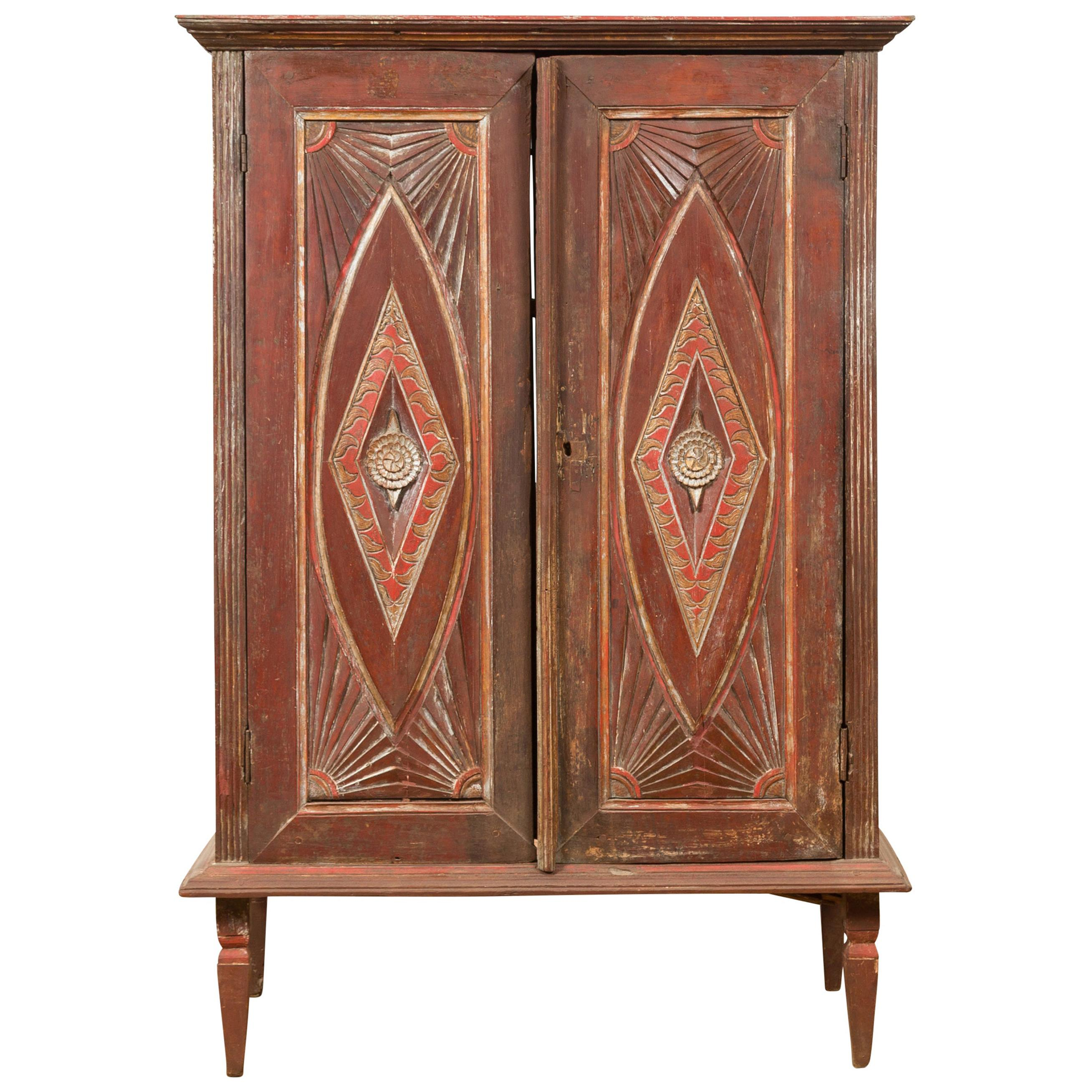 Antique Indonesian Wooden Cabinet with Carved and Painted Geometric Motifs