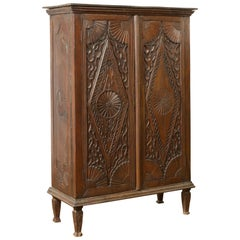 Antique Indonesian Wooden Cabinet with Carved Diamond Motifs and Medallions