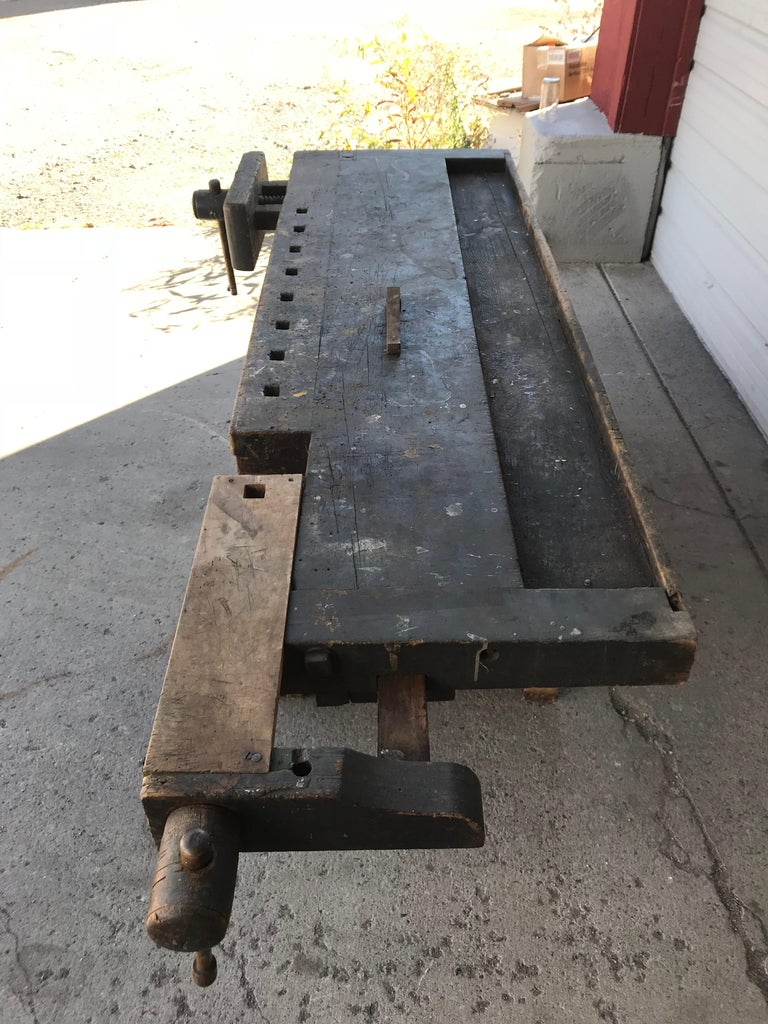 Antique industrial carpenters workbench, 2 vises, 2 drawers. Amazing patina, an interesting and well used craftsman's work bench from early 20th century, Hand delivery avail to New York City or anywhere en route from Buffalo NY.