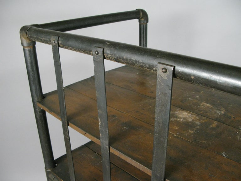 Mid-20th Century Antique Industrial Cast Iron Rolling Cart Bookcase For Sale