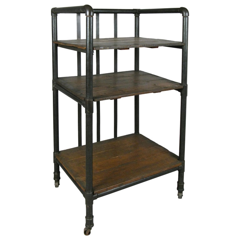 antique industrial cast iron rolling cart bookcase for sale at 1stdibs
