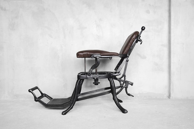 This Empire chair was manufactured in the beginning of 20th century. The frame is made from solid cast iron. The seat and backrest have been upholstered in genuine leather in chocolate brown color. The chair has a dual adjustable mechanism, which