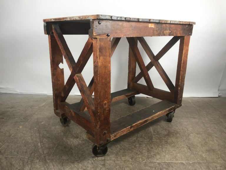 Antique Industrial factory work table on iron castors, simple design, handmade, heavy duty construction, hand delivery avail to New York City or anywhere en route from Buffalo NY.