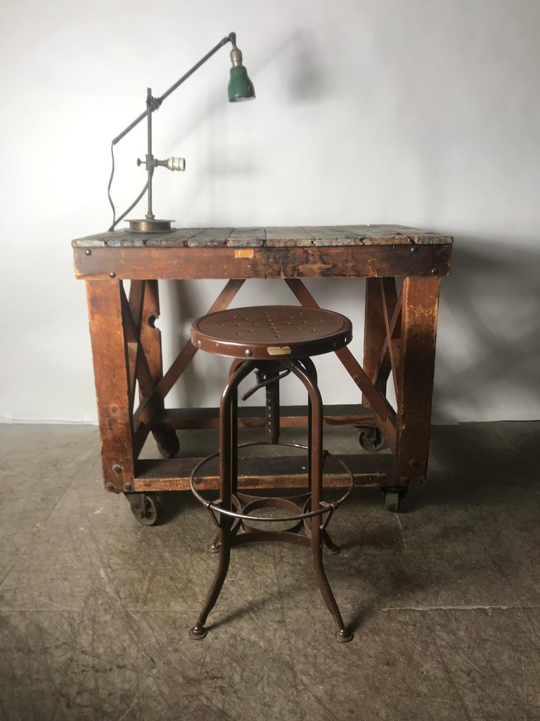Antique Industrial Factory Work Table on Iron Castors In Distressed Condition For Sale In Buffalo, NY