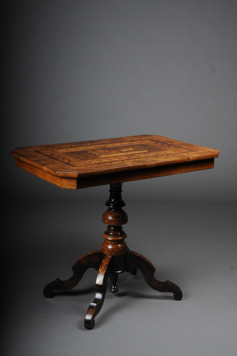 Antique inlaid table South German / Italy, circa 1845 Solid wood, walnut with maple inlays. Also in the center figurative scenery inlaid. Rectangular cover plate on baluster-shaped shaft which is also richly inlaid. Extremely high quality and rich