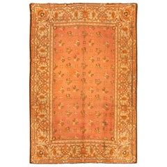 Antique Irish Donegal Carpet. Size: 6 ft 8 in x 9 ft 6 in (2.03 m x 2.9 m)