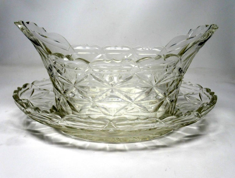 Stunning rare Irish heavy gauge handcut crystal fruit bowl of oval outline complete with original undertray, of outstanding quality and condition, circa 1800.