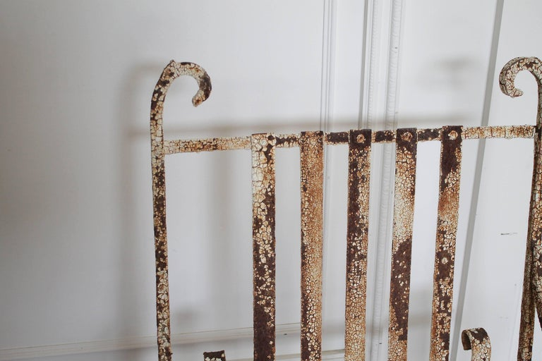 Antique iron garden armchair Original chippy patina, a solid heavy wrought iron chair. Great for decoration. Measures: 20