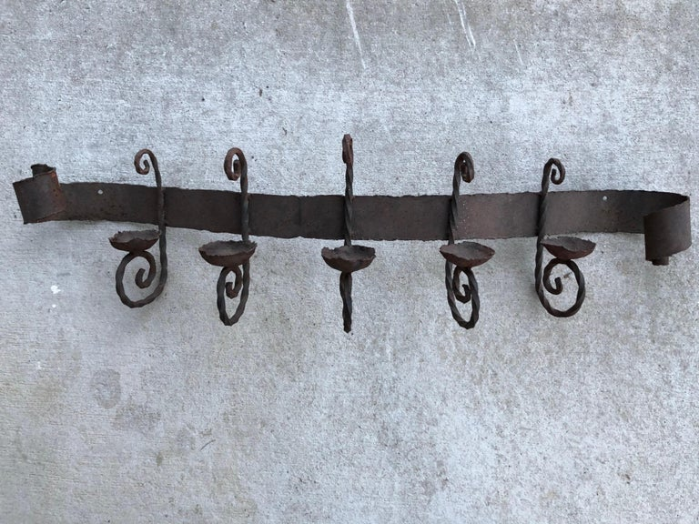 Hand-Crafted Antique Iron Wall Sconce For Sale
