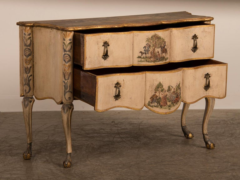 An antique Italian Baroque Rococo painted two-drawer chest from Italy, circa 1750. The softly undulating facade of this chest that stands upon cabriole legs showcases a unique combination of profile along with a delicately painted finish to create a