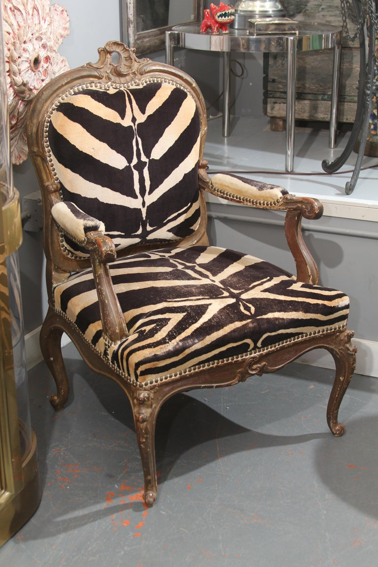 Curvy 19th century antique carved giltwood Italian chair upholstered in beautifully worn cotton velvet. Sturdy and comfortable, this is a very versatile and useable chair for almost any room. The care that was taken for fabric placement is top