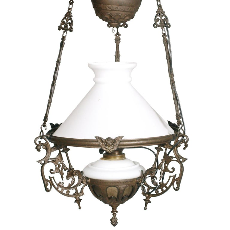 Antique Italian Art Nouveau chandelier, electrified and made from an oil lamp, in lattimo Murano glass and burnished bronze, height adjustable from cm 120 to cm 80. One light. Overhauled electrical system
