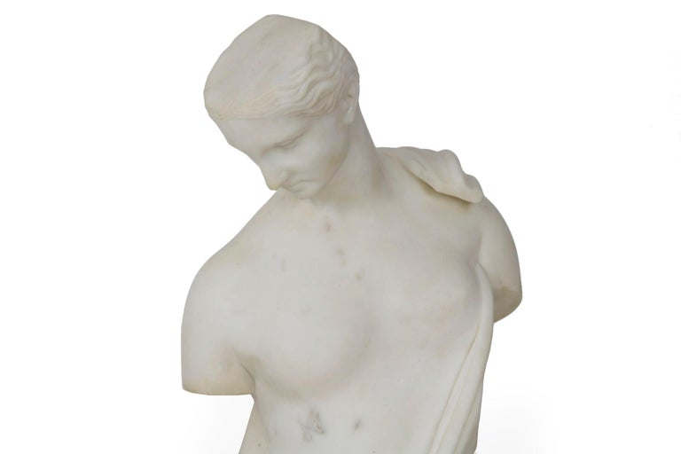 A finely chiseled marble sculpture of a goddess draped in a loose garb, it is signed in script T. Vacca along the side and dated 1866. The original was found in the amphitheater of Capua in Italy during the 18th century, the sculpture is believed to