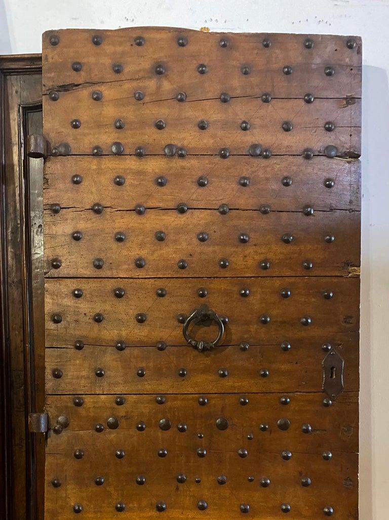 Stunning antique Italian door with original iron hardware.  Measurements: 40.5