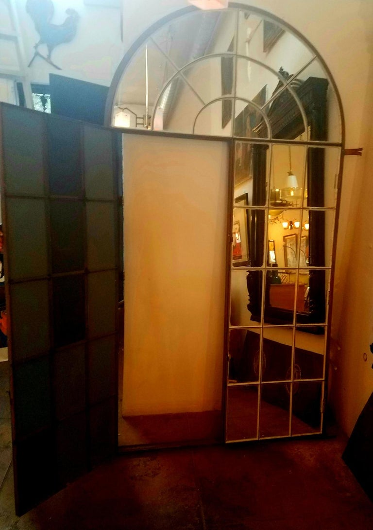 Venetian very large mirror. Frame has been transformed from the early 1900s veranda window-door made by black smith. The mirror frame will be a great addition to antique, Industrial, or contemporary setting.