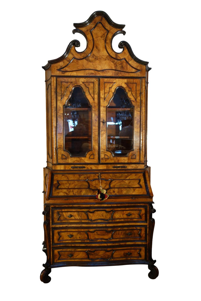 Exquisite Louis XIV Italian Trumeau cassettone version of the French Secretaire, featuring solid walnut and fine walnut burl veneer artistry. A lovely scale, both stately and delicate. The elegant two-tone colouration with ebonized decorative trim