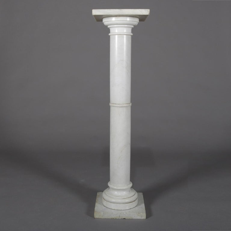 Antique carved Italian marble sculpture display pedestal features Corinthian column-form with stepped base and capital, circa 1890.  Measures: 47.5