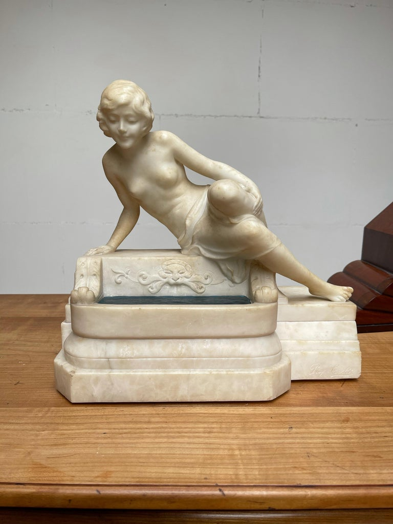 Hand carved white marble sculpture of a sitting maiden by a water well. By Emilio Fiaschi, Florence circa 1910.  This beautiful, impressive and elegant, sculptural table or desk lamp is another great find, because of its quality workmanship, its