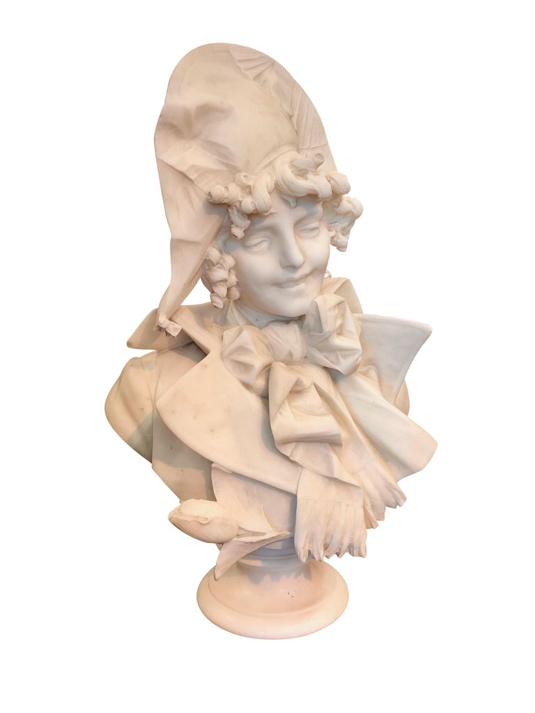 A charming 19th century Italian carved white marble sculpture of a smiling lady wearing a bonnet. The expression on the her face is simply captivating.  By: Ferdinano Vichi (1875-1945)  Height: 29.5