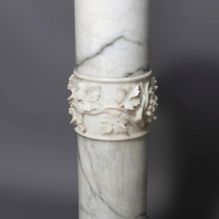 An antique Italian neoclassical sculpture display pedestal offers marble construction with Doric form having central carved grape and leaf band, circa 1890  ***DELIVERY NOTICE – Due to COVID-19 we are employing NO-CONTACT PRACTICES in the transfer