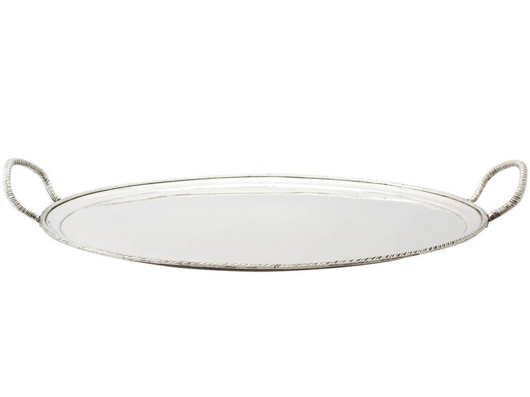An exceptional, fine and impressive antique Italian silver two handled tea tray; an addition to our continental silver collection.  This exceptional antique Italian silver tea tray has a plain oval form.  The surface of this Italian tray is