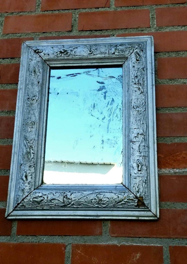 Antique mirror in original condition.
