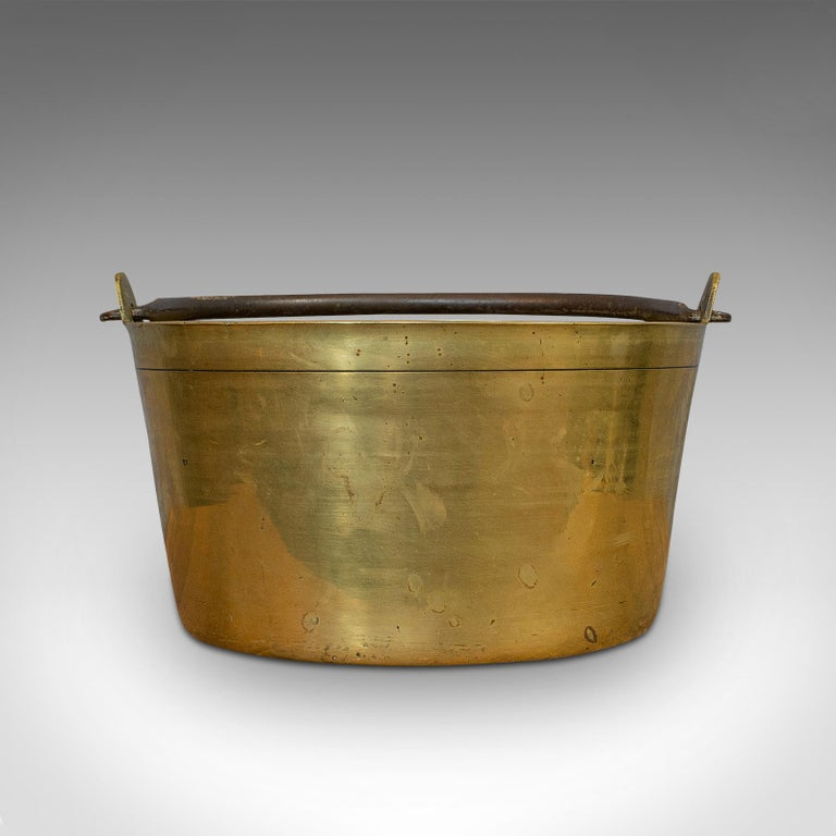 This is an antique jam pan. A French, solid brass artisan kitchen pot, dating to the late Victorian period, circa 1900.  Quality, French small batch cookware Displaying a desirable aged patina - pleasing weathering to the exterior Solid brass