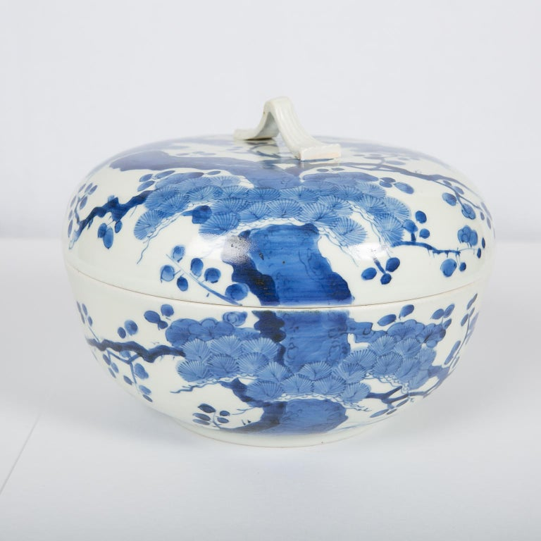 WHY WE LOVE IT: The creamy white and the vivid blue We are pleased to offer this beautiful Japanese blue and white porcelain covered bowl dated to the early Edo period (circa 1760). The body of this bowl has a smooth texture with soft luster,