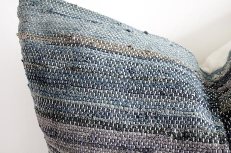 Antique Japanese Boro indigo pillow This cotton face features a multi indigo gray, and blue stripes that are woven, natural linen colored background with original threaded string. The backing is 100% Irish linen in natural linen. Our pillows are