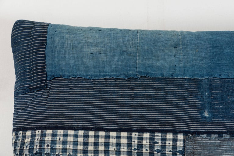 19th century Japanese patchwork indigo cotton reconfigured into a pillow with blue linen back, invisible zipper closure and feather and down fill.