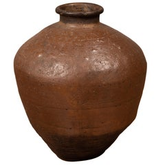 Antique Japanese Brown Oil Jar with Weathered Appearance and Irregular Shape