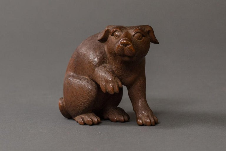 Antique Japanese hand carved puppy.  Expertly carved, showing a poised and alert puppy. Comes in original storage box with dedication, artist signature and collector's seal. Dedication reads: Puppy was purchased by a collector in 1940 for