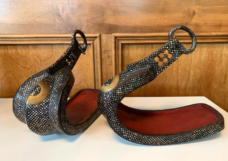 A pair of antique Japanese abumi, horse-riding stirrups for nobles or samurais, in cast iron of Nanban style with Agai (abalone shell) inlay, circa Momoyama to Edo period (16th-17th century) . The prototype of Japanese abumi of this