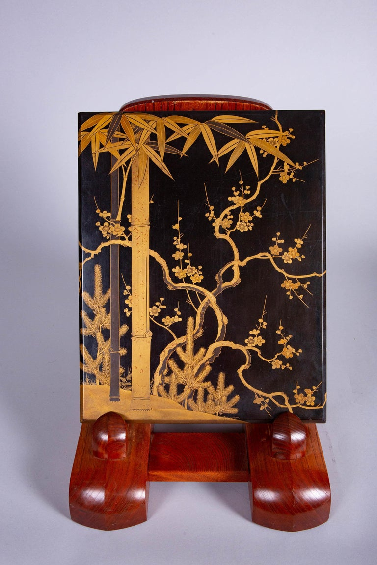 Plumb, bamboo and pine are known as the three friends of winter because they stay green and or bloom in the snow. Decorated in gold with bits of heavy gold. Inside of lid has fern and grass design, also in gold.  (does not come with presentation