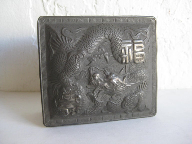 Great antique Japanese metal relief stash/cigarette box. Has a dragon design on the lid and then on the sides of the box. Marked