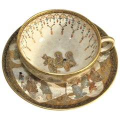 Antique Japanese Satsuma Teacup & Saucer Set with Ornate Hand Painted Decoration
