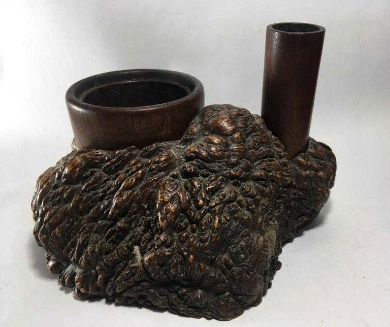 On offer is an antique Tabaco-Bon, a pleasure item from Japan circa Meiji period. The piece was fashioned out of a block of natural burl wood with beautiful gnarled surface texture, It carries deep patina from the handling and reflects the concept