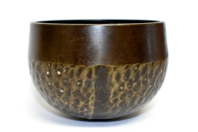 A handmade solid bronze singing bowl with unique tiger stripe pattern. This bowl produces a soothing and thought provoking tone. Such a bowl was used in the Japanese temple to sync energy between human and nature. They summon blessings, clear one's