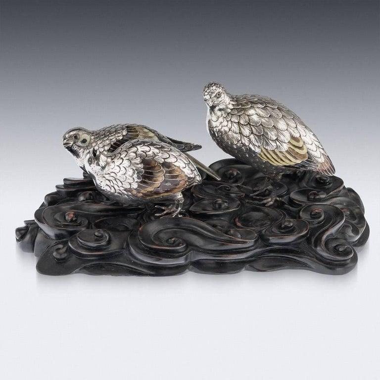 Antique late 19th century Japanese Meiji period very fine silver figures of quails, on a carved wood stand. The naturalistically modeled birds decorated with enamelled eyes and plumage, with realistically engraved feathers. Tested to be 950+ high