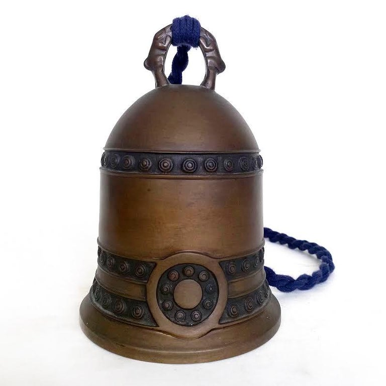 Antique Japanese Tsuri-kane Buddhist bronze bell, Meiji period.  Traditional bronze Buddhist bell with long wood striker is decorated with three bands around the body containing incised round circles. The two bottom bands are anchored with an oval