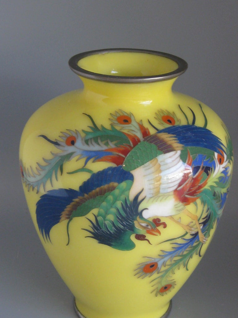 Beautiful antique Japanese cloisonné enamel vase featuring a Hoo-oo bird and dating from the Meiji era. The vase features colorful cloisonné decorations and details. High quality and made well. In very nice original condition for its age. No chips,