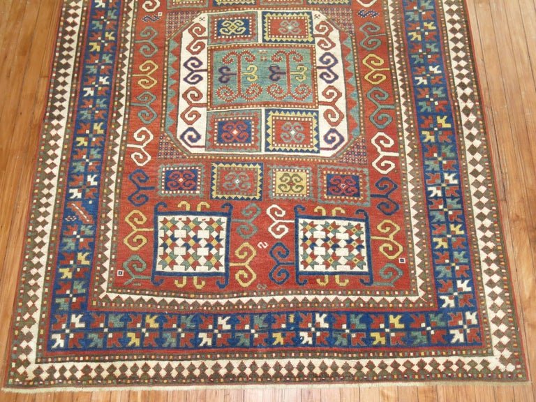 An early 20th century rare intermediate size Caucasian Karachopt Kazak rug.