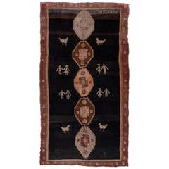 Antique Kars Rug, Black Field with Animal Motifs and People Motifs, Pink Accents