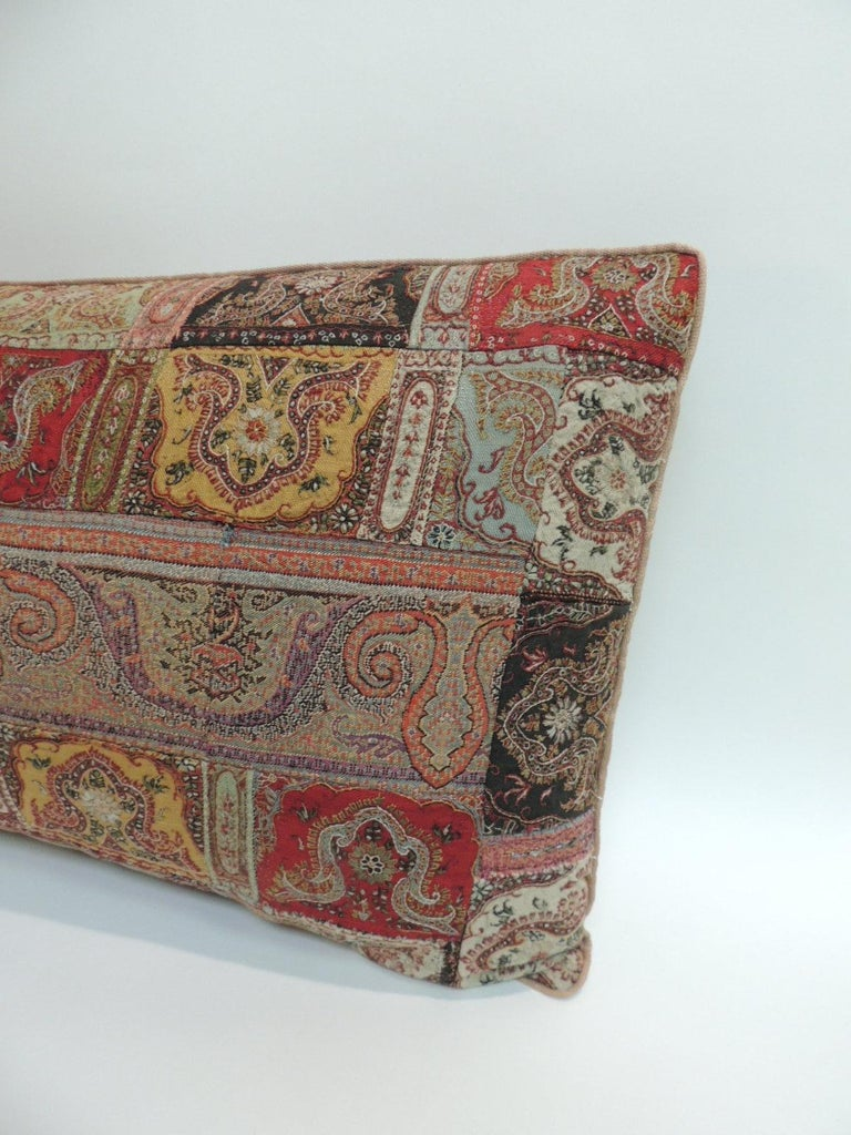 Antique Kashmir patchwork paisley long bolster decorative pillow. Decorative pillow in shades of red, green, yellow, black and brown. Decorative pillow handcrafted and designed in the USA. Closure by stitch (no zipper closure) with custom made