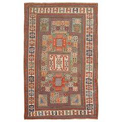 Antique Kazak Caucasian Rug. Size: 4 ft 7 in x 7 ft 1 in (1.4 m x 2.16 m)