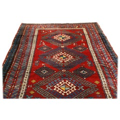 Antique Kazak Transitional Geometric Red and Blue Wool Rug with Dyrnak Guls