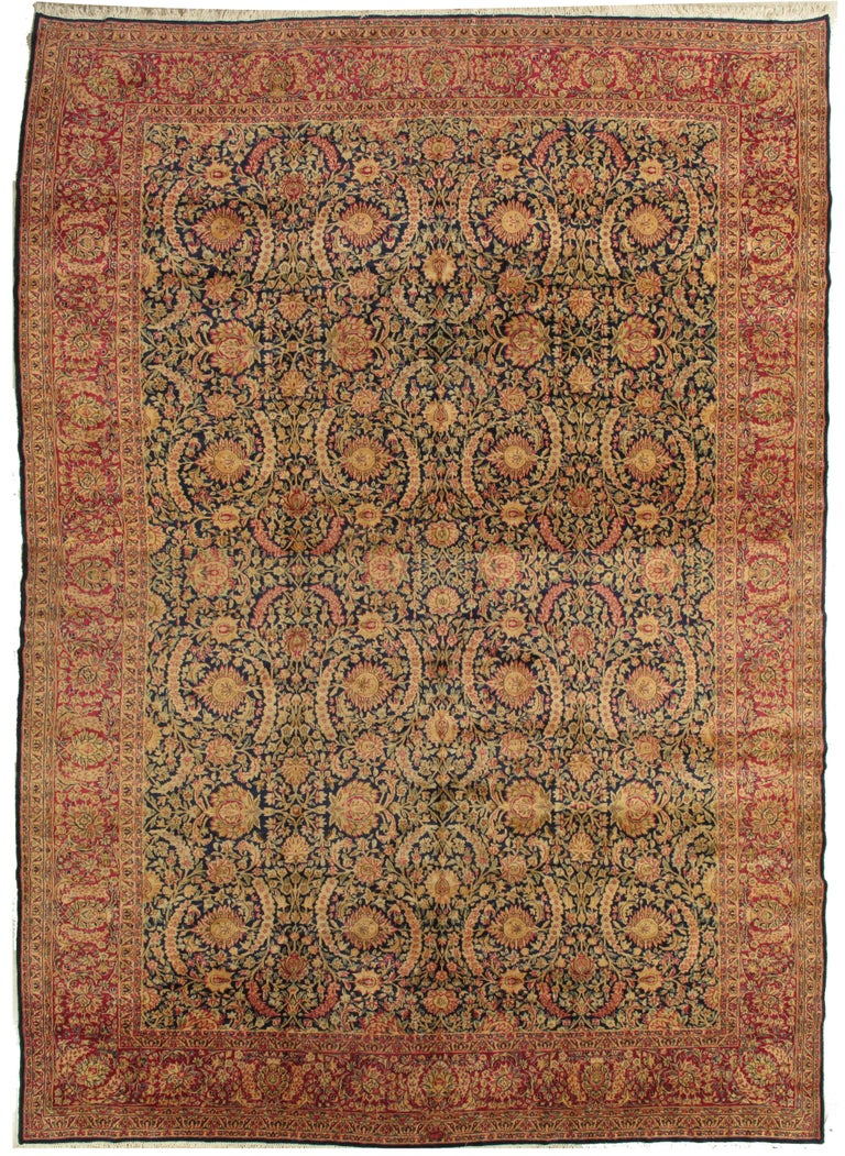 This master crafted Persian Kerman carpet exemplifies the profound understanding of the artistic principles of balance and harmony that make art-level antique rugs so inspiring to live with. Indicative of the best classical Persian carpets of its