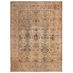Antique Kerman Lavar Blue and Yellow Wool Rug with All-Over Floral Patterns